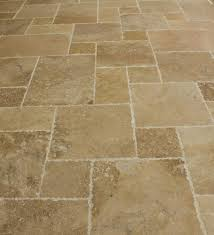 Distressed travertine tiles on floor in a pattern in Gilbert AZ